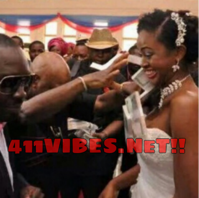 Arthur Eze Spraying blocks Of cash on a bride 411vibes.png