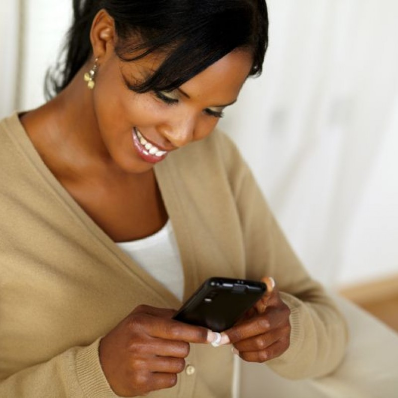 Woman-Looking-At-Phone-Smiling-The-Trent-795x530