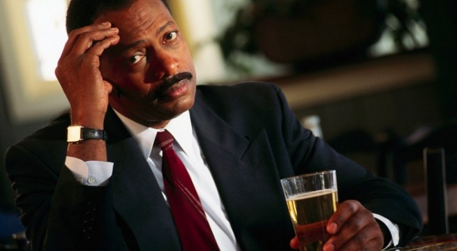Man-worried-with-drink-TheinfoNG-700x466