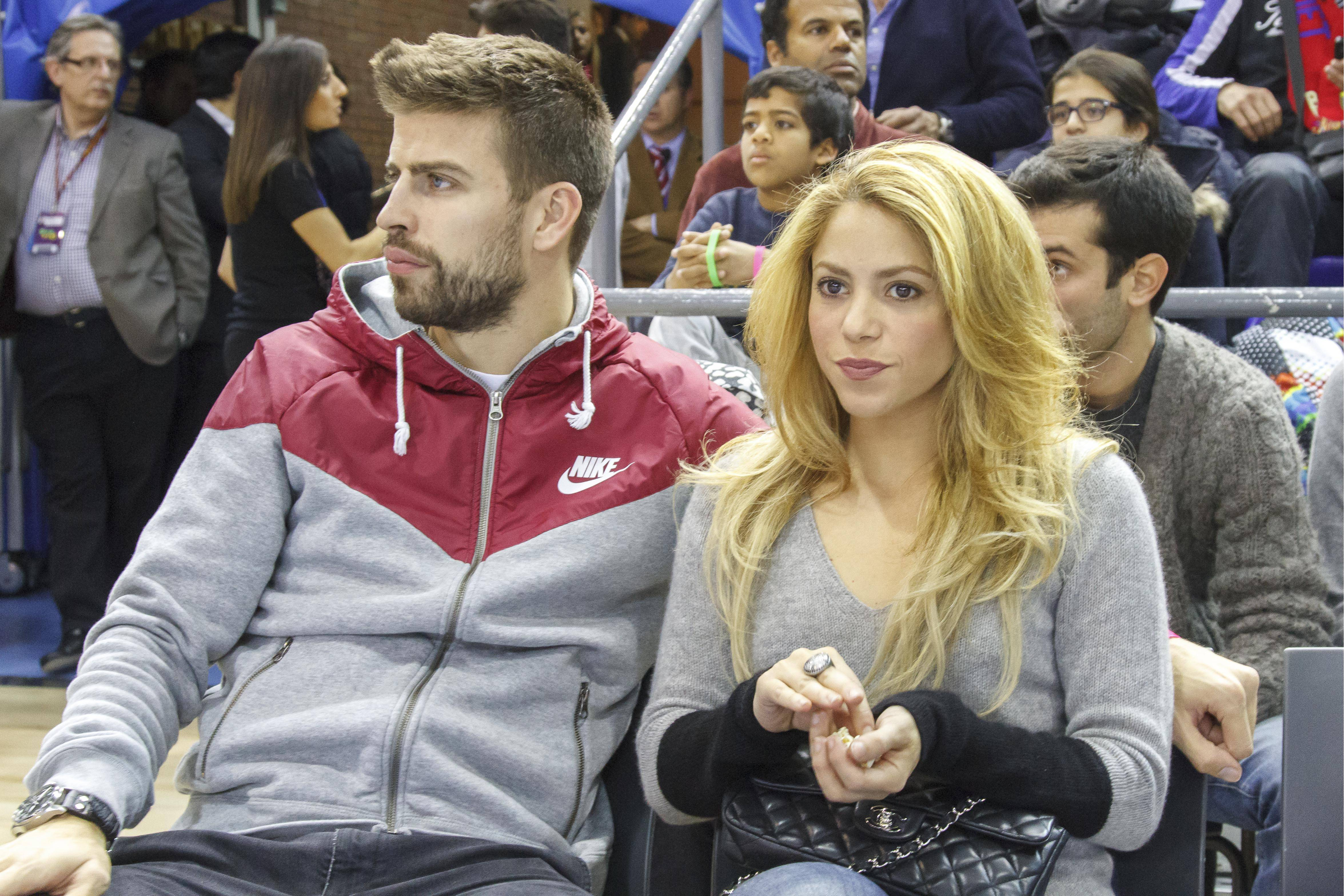 Shakira and Gerard Pique attend a Basketball match in Barcelona. Pictured: Shakira and Gerard Pique Ref: SPL659234 011213 Picture by: Splash News Splash News and Pictures Los Angeles: 310-821-2666 New York: 212-619-2666 London: 870-934-2666 photodesk@splashnews.com