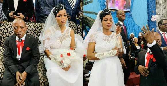 Bride looks sad at her wedding.