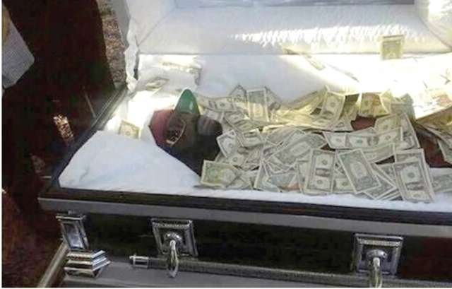 Man buried with money