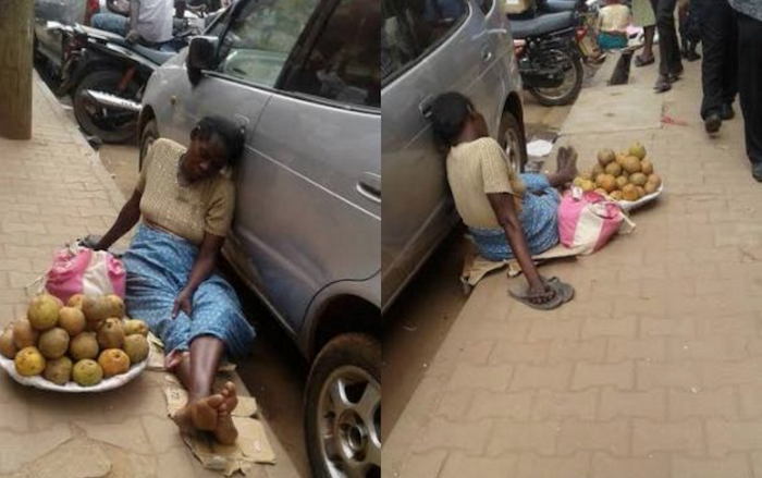 Heart-wrenching photos of an exhausted street trader who fell asleep on the road theinfong.com 700x439