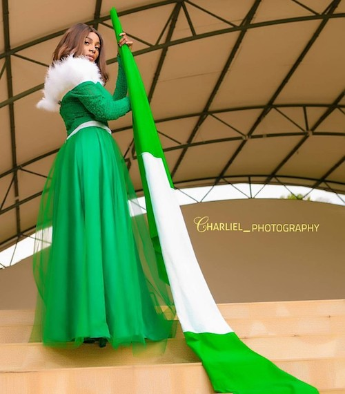 Girl stands with Nigerian flag