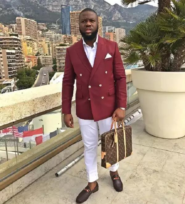 Hushpuppi in suite carrying designer bag