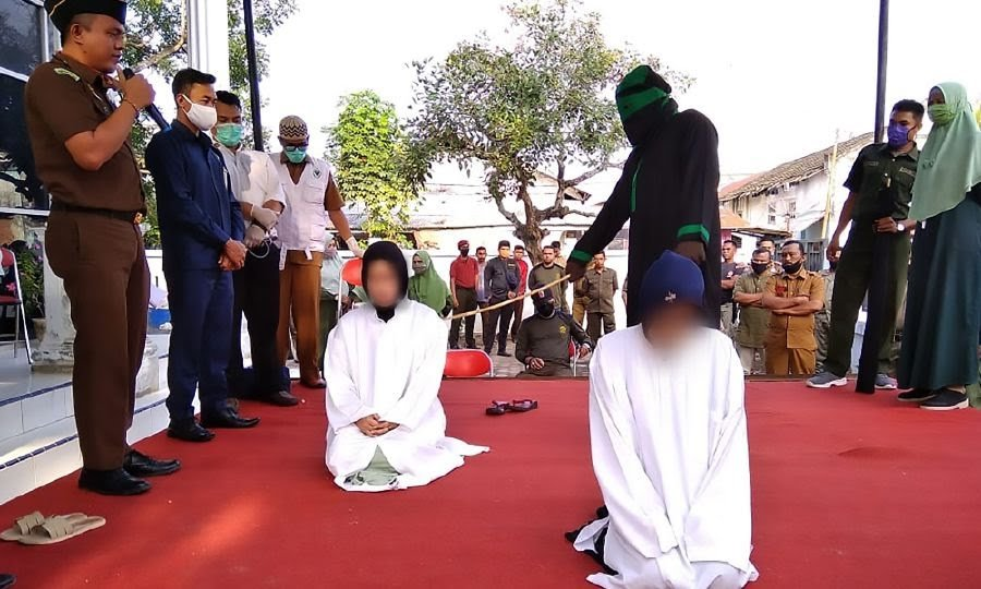 indonasian women beaten publicly
