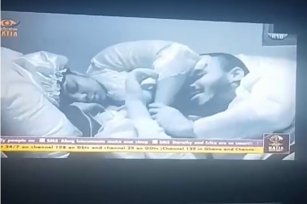 #BBNaija Ozo rests his head on Dorathy's 'chest' as she rubs his cheeks after a late night discussion video -