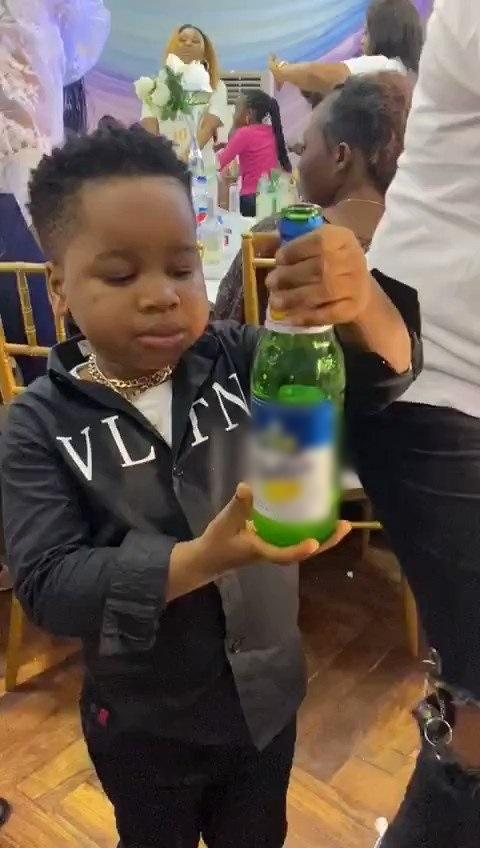 little boy taking alcohol