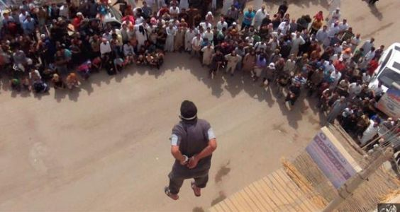 ISIS militants throw gay man from rooftop, killing him t