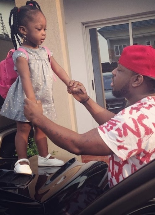 Timaya plays with daughter