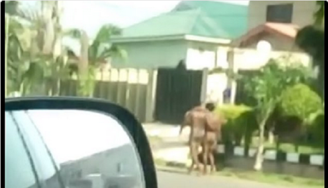 the-two-naked-men-strolling-in-abuja