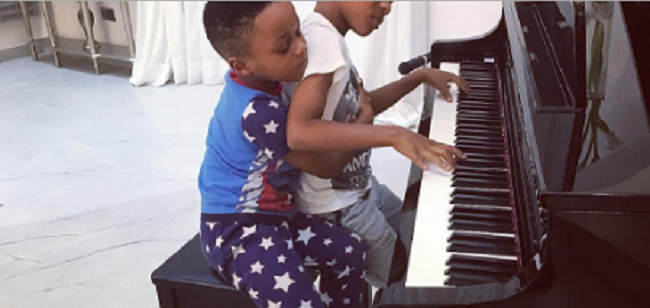 peter-paul-okoyes-sons-playing-the-piano