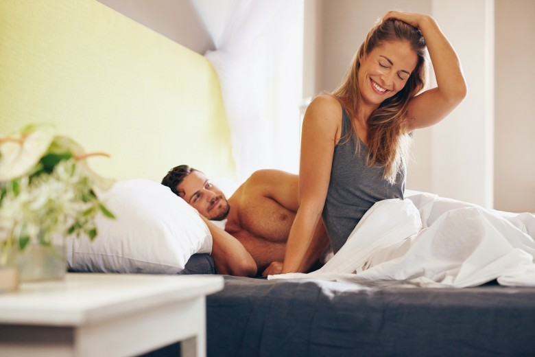 bigstock-Happy-Young-Couple-Waking-Up-I-91103918