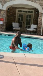 Davido teaches his second daughter, Hailey how to swim
