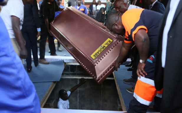 Robert Mugabe buried in steel coffin as family claims people are 'after his body'