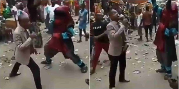 Pastor and masquerade fight for attention at Market (Video)