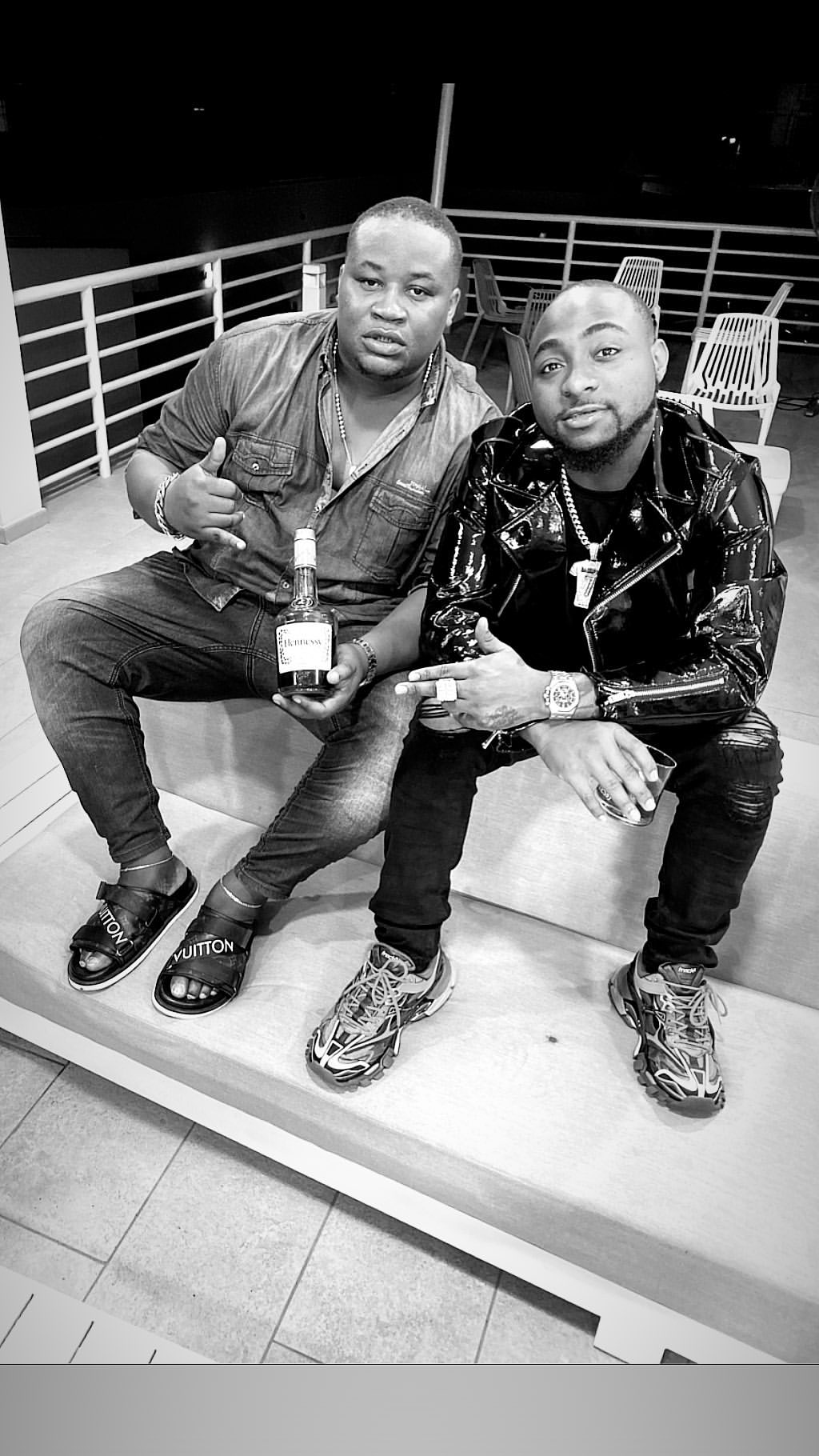 Davido parties with Club Cubanna Chief priest as they celebrate Mercy's win (Photos and Video)
