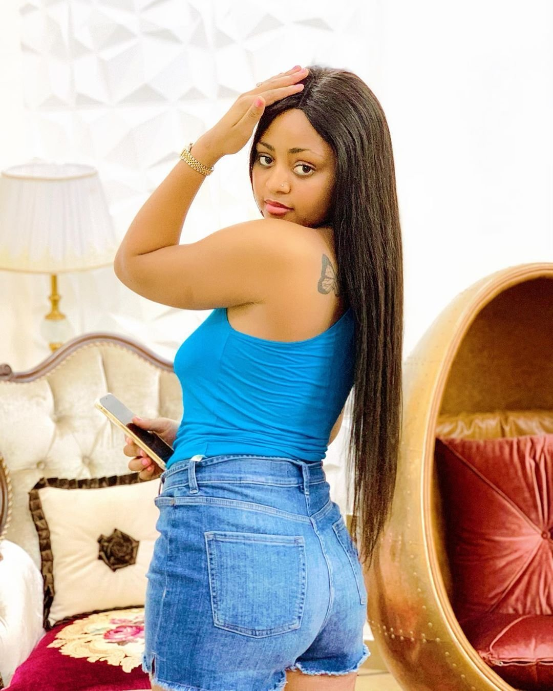 Check out all Regina Daniels' 7 tattoos and what they mean