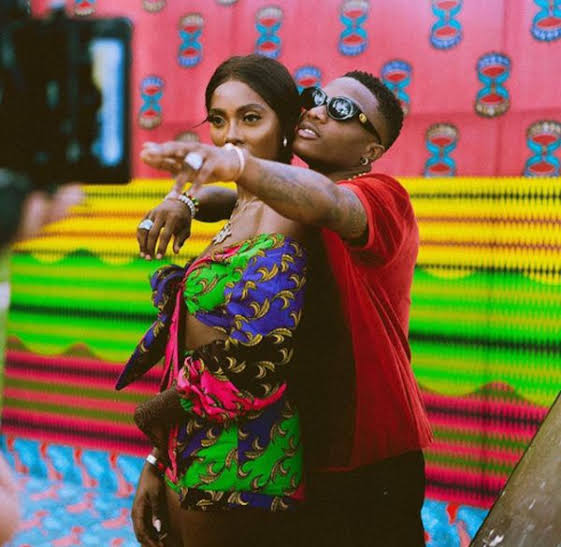 Tiwa Savage clearly unhappy as Wizkid grabs her from behind on stage - See her body language (Video)