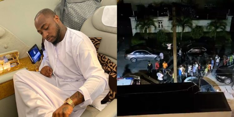 Davido shares money for crowd who refused to leave his Lekki mansion (Video)