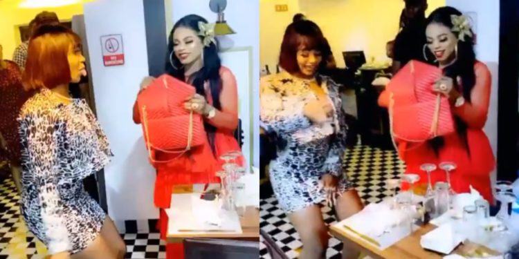 Bobrisky empties her purse as he sprays money on Tacha at her birthday bash (video)