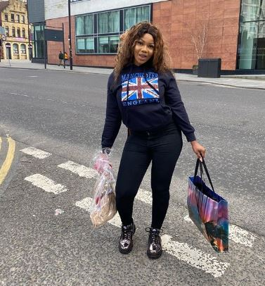 Tacha returns to Lagos from UK amidst airport shutdown, promises to share relief materials to fans (Video)
