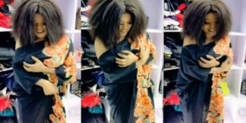 Bobrisky grabs his fake breasts as they almost fall off the bra in new video