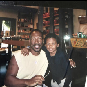 Back in the days with Eddie Murphy - Osita 'Paw paw' Iheme drops epic throwback photo with American star