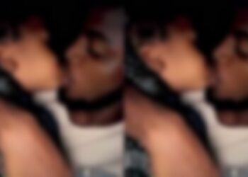 Nigerians lash at grownup man for 'french kissing' little girl (Video)