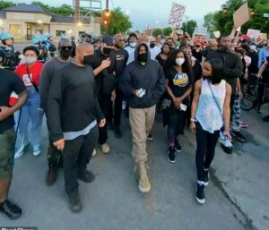 Kanye West joins protesters to march round streets of Chicago, hours after donating $2million
