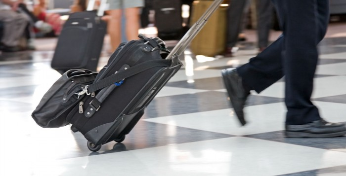 Man-travelling-in-airport-700x357