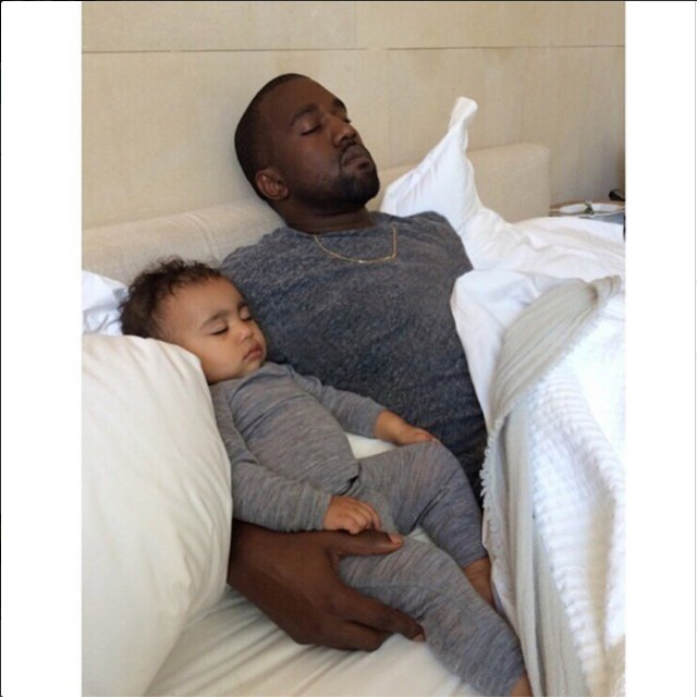Kanye-West-napping-with-baby-North
