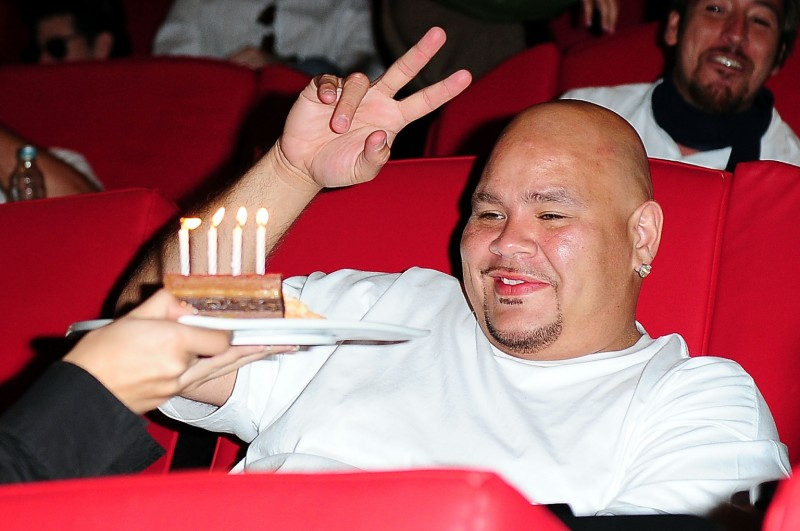 """MIAMI - AUGUST 19: Fat Joe is given a cake on his birthday during a listening party for Pitbull's latest release """"Rebelution"""" at Cinebistro on August 19, 2009 in Miami, Florida. (Photo by Gustavo Caballero/Getty Images)"""