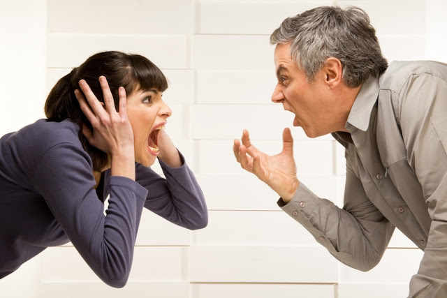 smaller couple_fighting_her_hands_over_ears