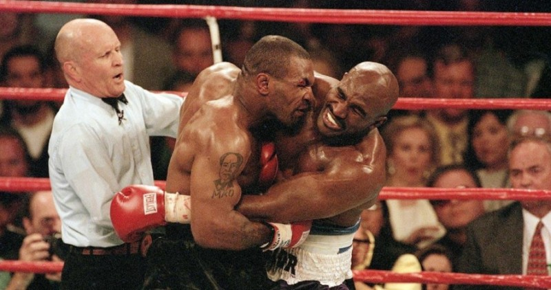 Tyson-bites-Holyfield-quickstopmedia